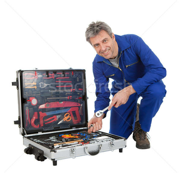 Automechanic taking a wrench out of toolbox Stock photo © AndreyPopov