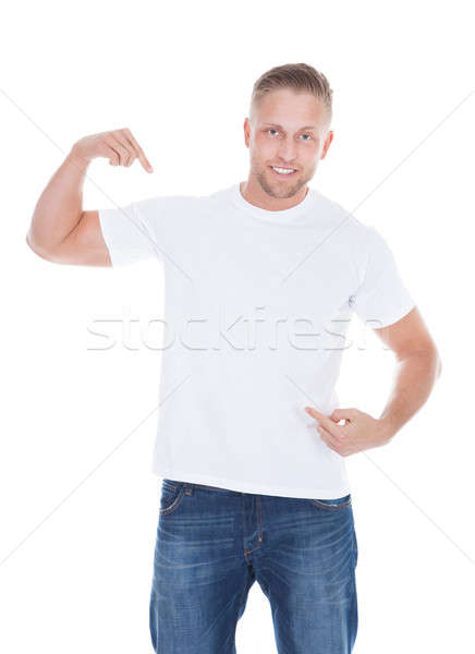 Man pointing at his blank white t-shirt Stock photo © AndreyPopov