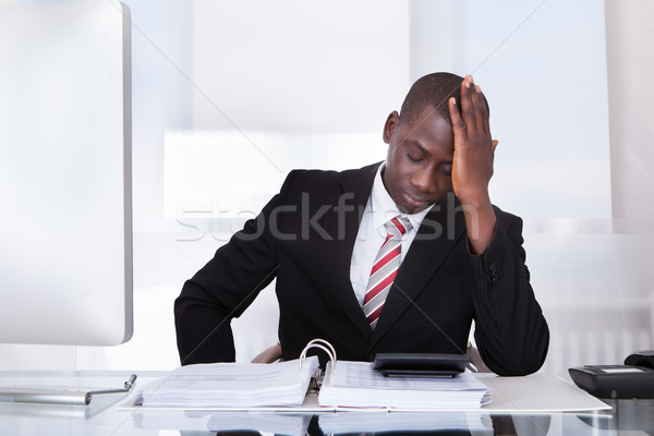Frustrated Businessman At Desk Stock photo © AndreyPopov
