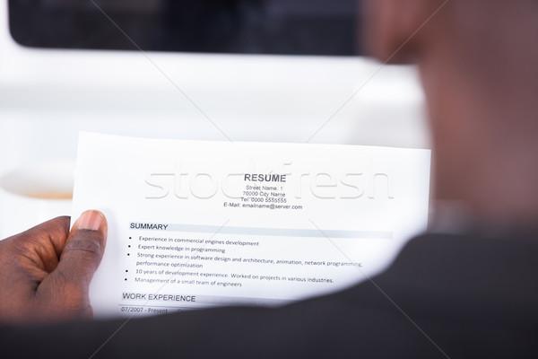 Személy olvas önéletrajz közelkép üzletember néz Stock fotó © AndreyPopov