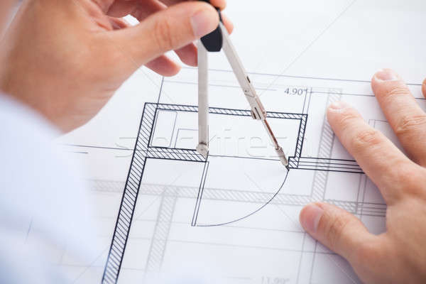 Male Architect Using Divider On Blueprint Stock photo © AndreyPopov