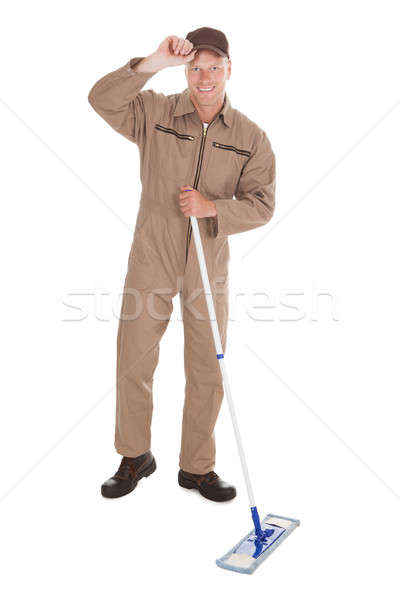 Confident Cleaner Mopping Over White Background Stock photo © AndreyPopov