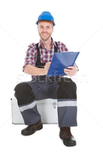 Manual trabalhador escrita clipboard branco Foto stock © AndreyPopov