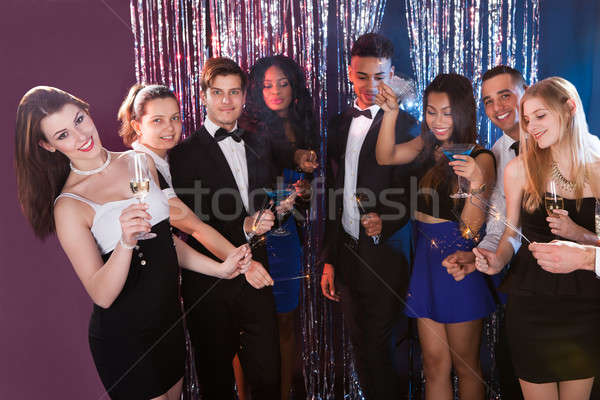 Happy Friends Celebrating At Nightclub Stock photo © AndreyPopov