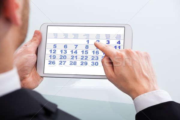 Imprenditore toccare calendario data digitale tablet Foto d'archivio © AndreyPopov