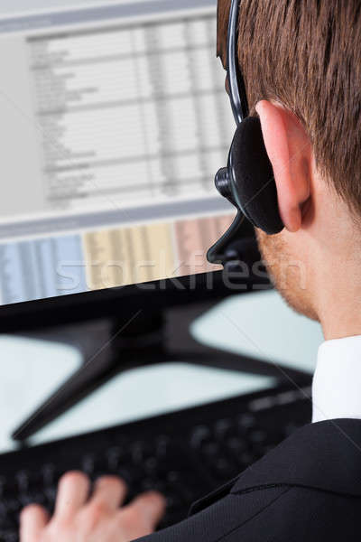 Call Center Representative Wearing Headset Stock photo © AndreyPopov