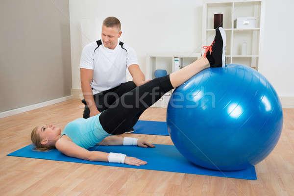 Instructeur naar vrouw mannelijke man sport Stockfoto © AndreyPopov