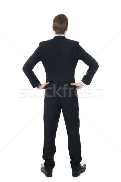 Confident Businessman Standing With Hands On Hips Stock photo © AndreyPopov