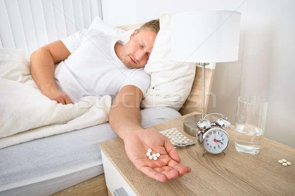 Man Holding Pills Stock photo © AndreyPopov