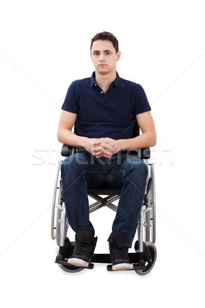 Confident Man Sitting With Hands Clasped In Wheelchair Stock photo © AndreyPopov