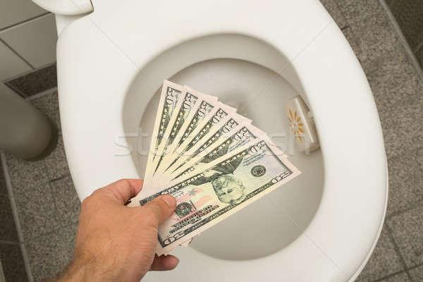 Wasting money concept Stock photo © AndreyPopov