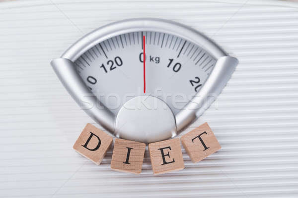 Diet Blocks Arranged On Weighing Scale Stock photo © AndreyPopov
