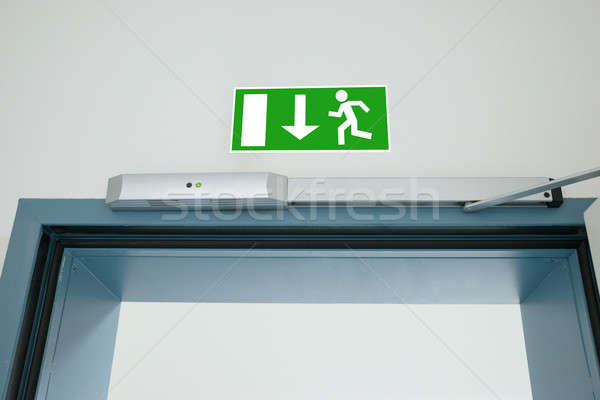 Emergency Evacuation Sign Stock photo © AndreyPopov