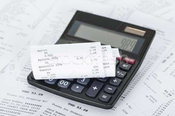 Calculator and Receipts With Costs Stock photo © AndreyPopov