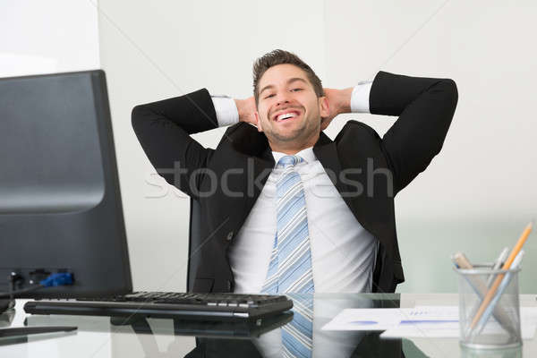 Relaxed Businessman With Hands Behind Head At Desk Stock photo © AndreyPopov