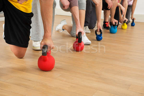 People Holding Colorful Kettle Bell Stock photo © AndreyPopov