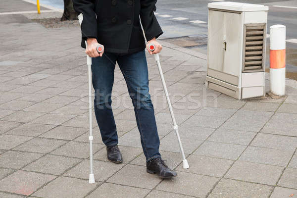 Man Trying To Walk Using Crutches Stock photo © AndreyPopov