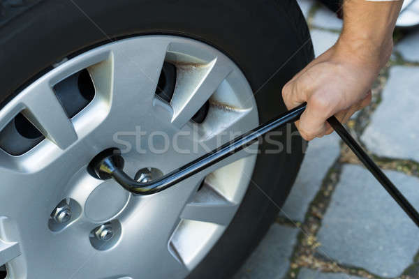 Man Changing Wheel Of A Car Stock photo © AndreyPopov