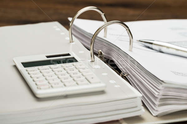 Invoice With Calculator And Pen Stock photo © AndreyPopov