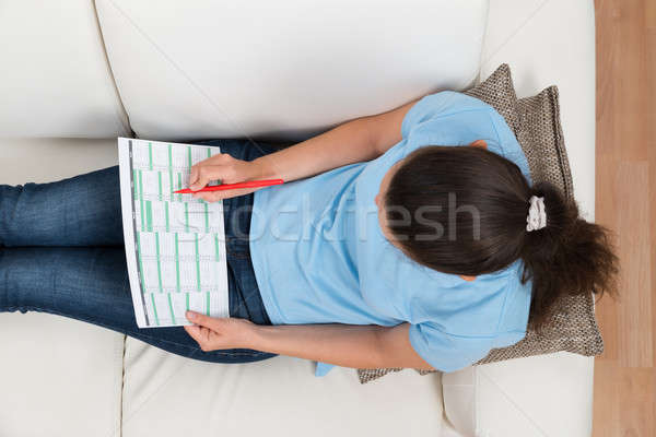 Woman On Sofa With Calendar And Pen Stock photo © AndreyPopov
