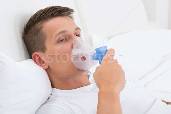 Man Breathing Through Inhaler Mask Stock photo © AndreyPopov