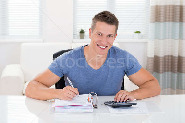 Man Doing Calculation At Home Stock photo © AndreyPopov