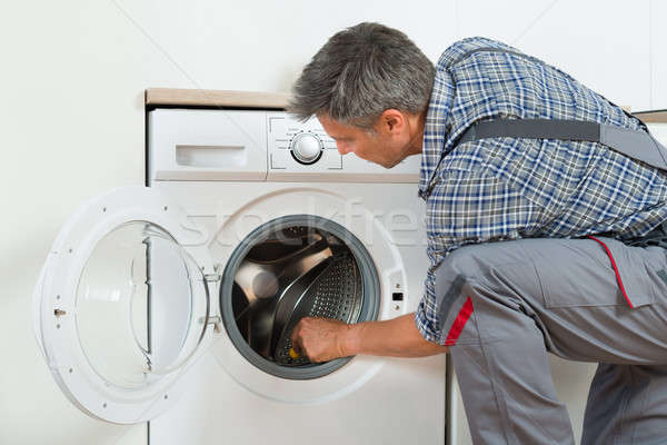 Repairman Checking Washing Machine At Home Stock photo © AndreyPopov