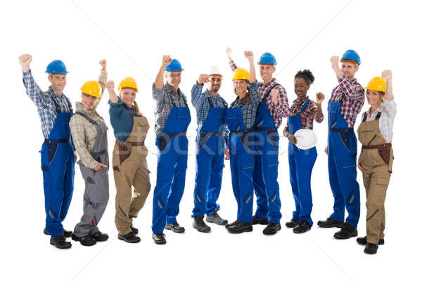 Happy Carpenters Standing With Arms Raised Stock photo © AndreyPopov
