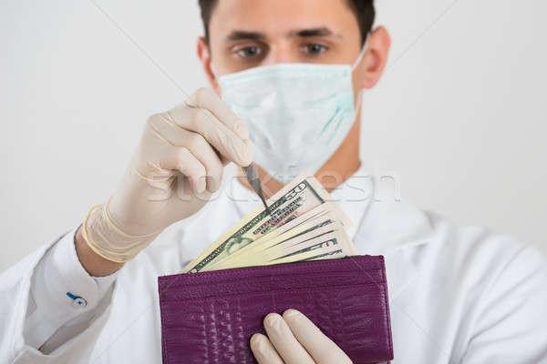 Mannelijke chirurg bankbiljet portemonnee witte man Stockfoto © AndreyPopov