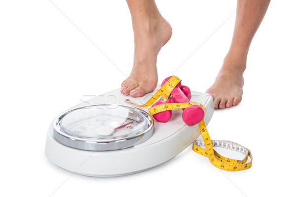 женщину веса масштаба гантели рулетка низкий Сток-фото © AndreyPopov