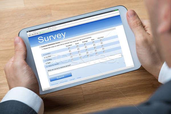 Stock fotó: üzletember · online · felmérés · digitális · tabletta · kép