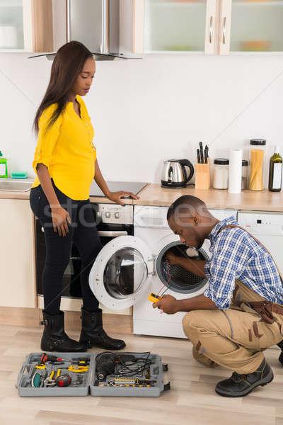 техник стиральная машина молодые афроамериканец кухне Сток-фото © AndreyPopov