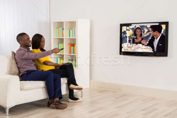 Boldog pár tv nézés afrikai otthon ház Stock fotó © AndreyPopov