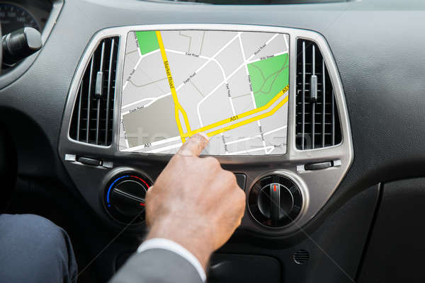 Person's Hand Using GPS Navigation System Stock photo © AndreyPopov