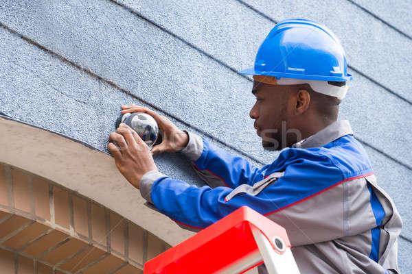 Technician Installing Camera On Wall Stock photo © AndreyPopov