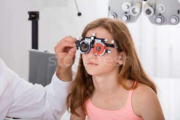 Optometrikus lányok előrelátás keret közelkép szem Stock fotó © AndreyPopov
