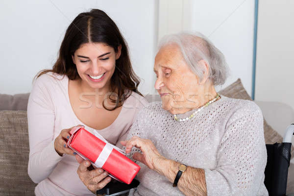 Grandmother Giving Gift To Her Granddaughter Stock photo © AndreyPopov