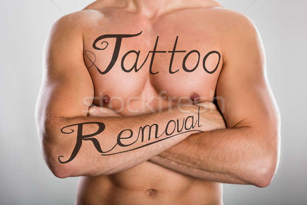 Tattoo Removal Text On Man's Chest And On His Arm Stock photo © AndreyPopov