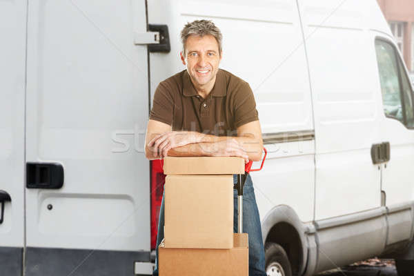 Portrait Of A Smiling Delivery Man Stock photo © AndreyPopov