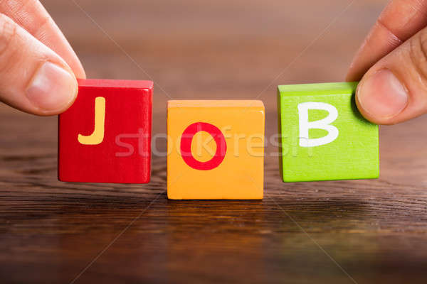 Person Arranging Blocks For Making The Word Job Stock photo © AndreyPopov