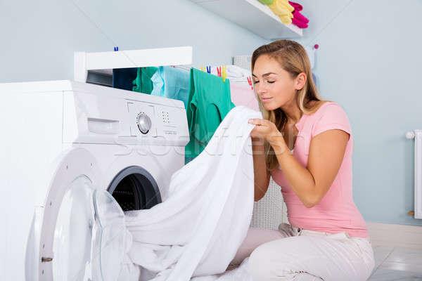 Kadın elbise elektronik yıkayıcı genç kadın temizlemek Stok fotoğraf © AndreyPopov
