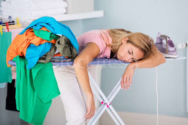 Tired Woman Sleeping On Ironing Board Stock photo © AndreyPopov
