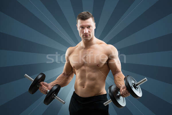 Young Man Lifting Weights Stock photo © AndreyPopov