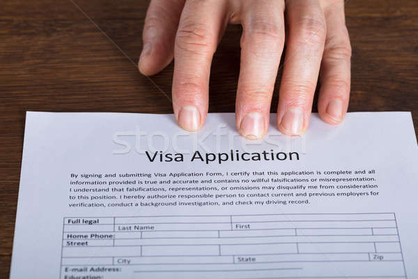 Personne main visa demande forme Photo stock © AndreyPopov