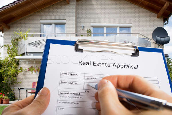 Person Hand Filling Real Estate Appraisal Document Stock photo © AndreyPopov
