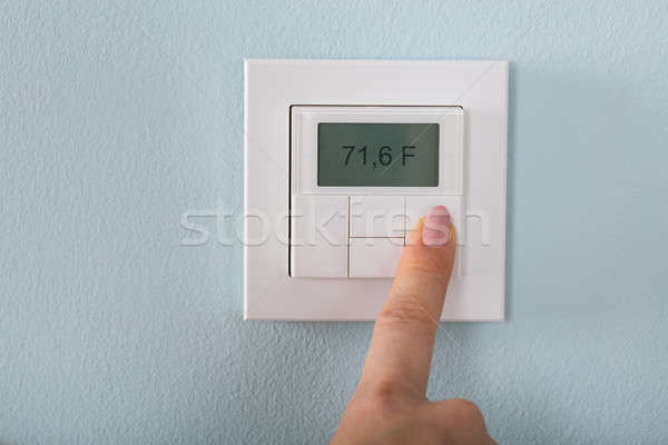 Person Setting The Thermostat Stock photo © AndreyPopov