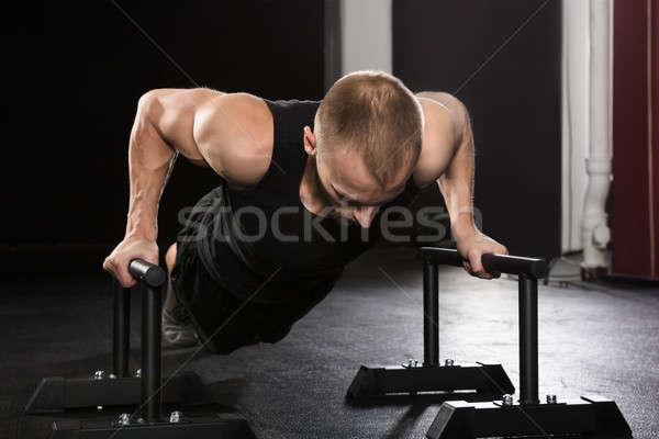 Man Doing Push-up Exercise Stock photo © AndreyPopov
