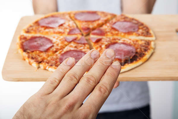 Person Rejecting To Eat Pizza Stock photo © AndreyPopov