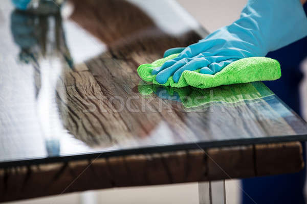 Janitor's Hand Cleaning Desk With Cloth Stock photo © AndreyPopov