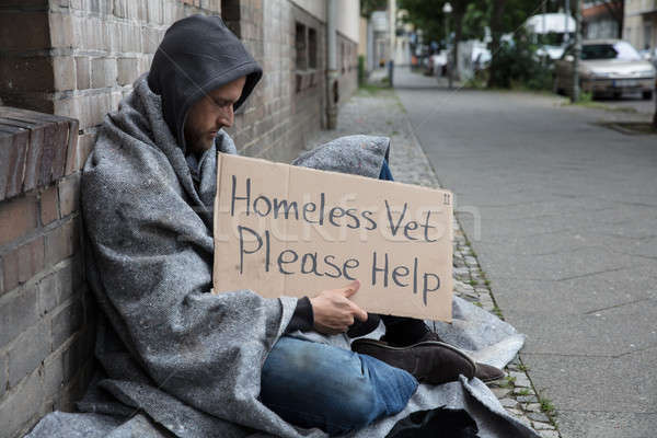 Male Homeless Sitting On A Street Asking For Help Stock photo © AndreyPopov